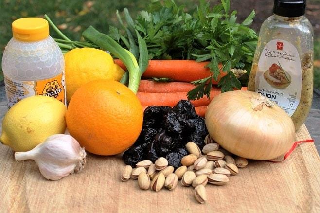 Chicken. lemon, orange, honey, pistachios, carrots, parsley, Dijon, green onions, prunes, garlic, onion, Pistachios