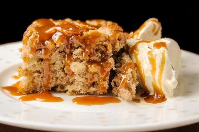 Apple Cake with bourbon Caramel Sauce and ice cream on plate f