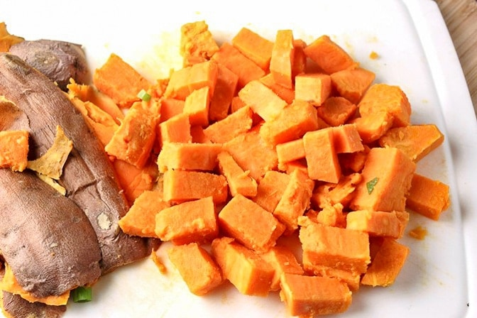 Sweet Potato cubes cooked in microwave on cutting board