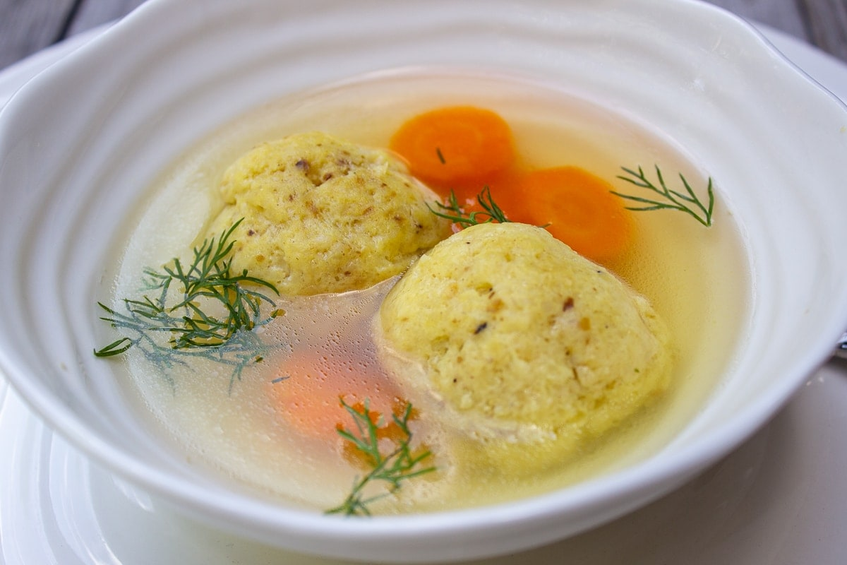 chicken soup in bowl with matzo balls