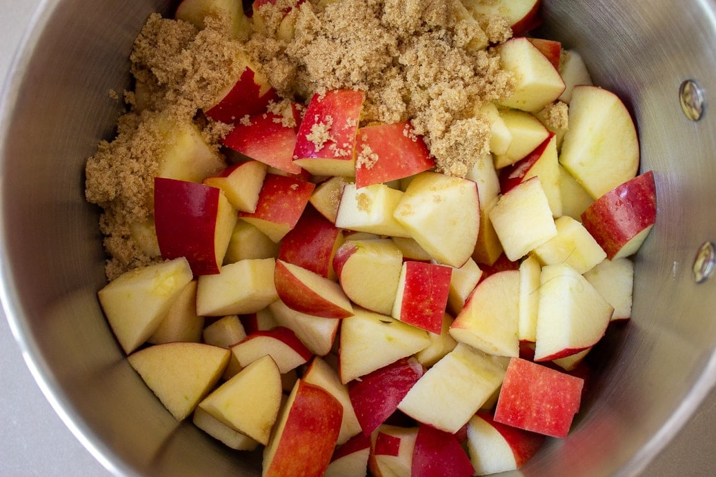 cut up apples, brown sugar and cinnamon in pot