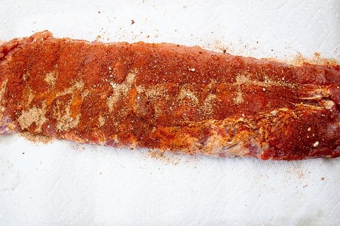 rib seasoned with rib rub on cutting board