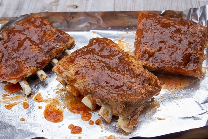 one back ribs cut in 3 pieces with glaze brushed on ready to grill or broil