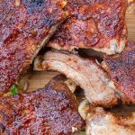 cut of ribs with glaze on cutting board p2