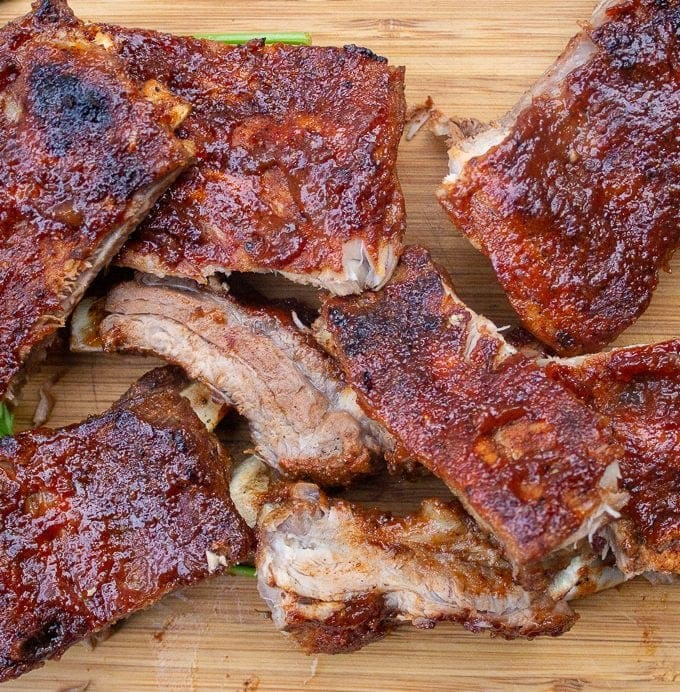 Baby back Ribs cut up on a wooden cutting board f