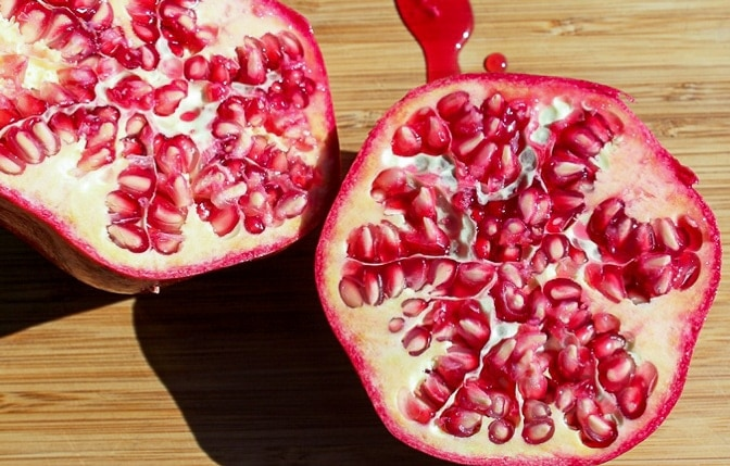 pomegranate cut in half exposing seeds