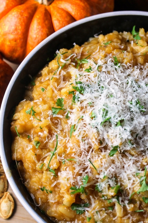 slow cooker pumpkin risotto in bowl garnished with parmesan cheese p