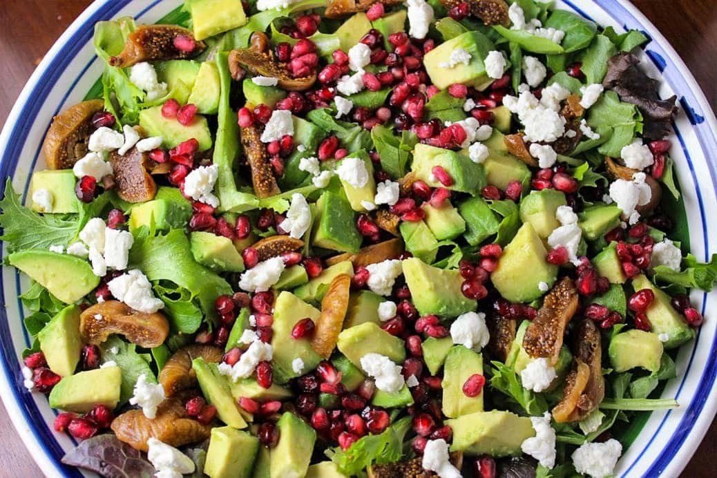 Fig salad with pomegranates in serving bowl