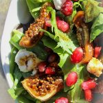 fig salad with pomegranate seeds in bowl