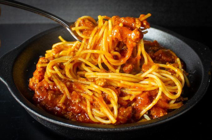 spaghetti and meat sauce on a plate f