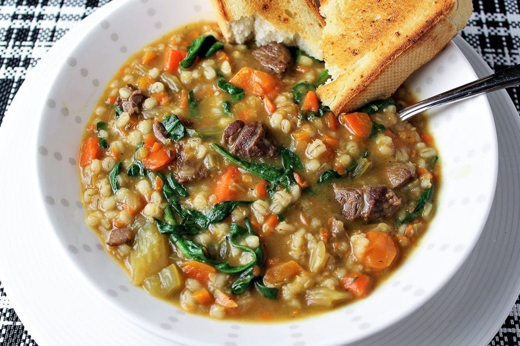 Beef Barley Soup in bowl with toasted bread