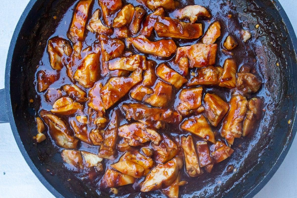 chicken in bourbon chicken sauce in pan