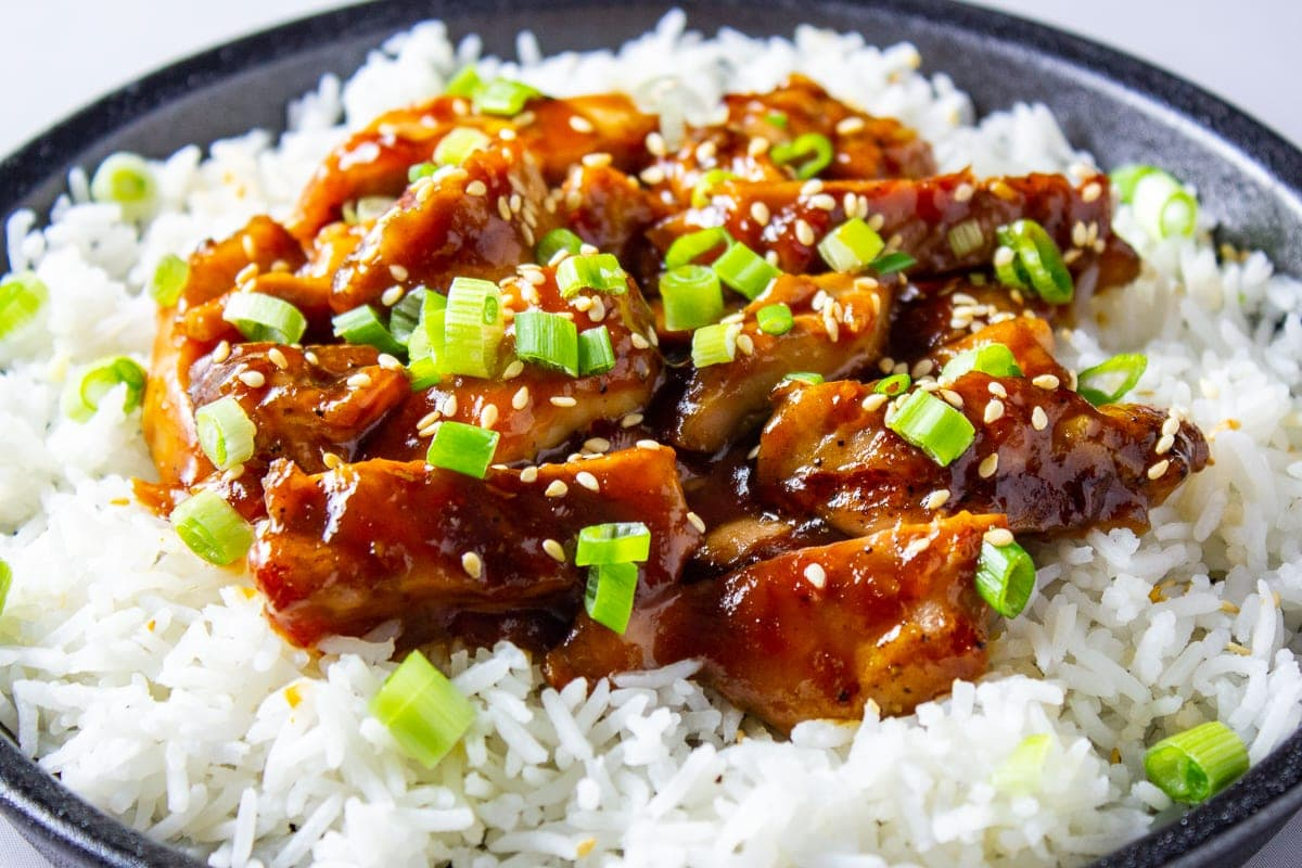 bourbon chicken over rice on plate 2