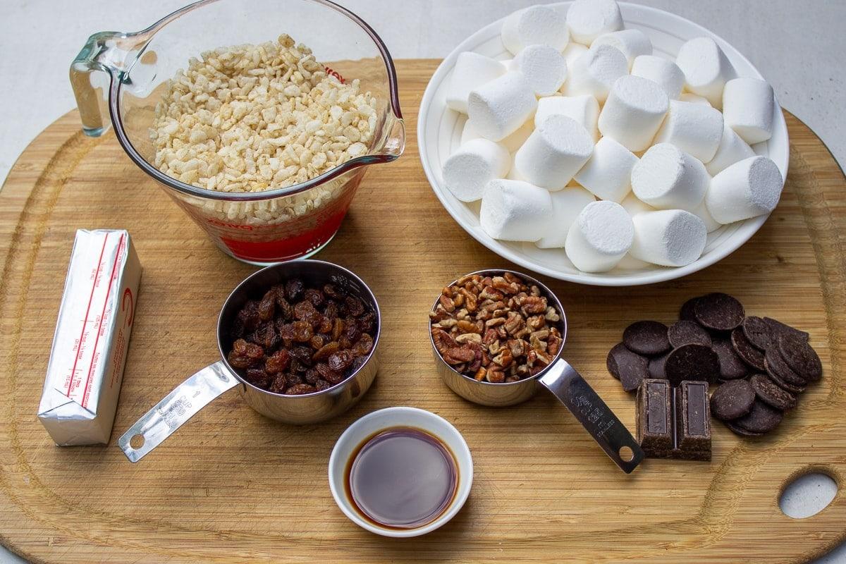 rice krispies, marshmallows, nuts, raisins, vanilla, butter, chocolate
