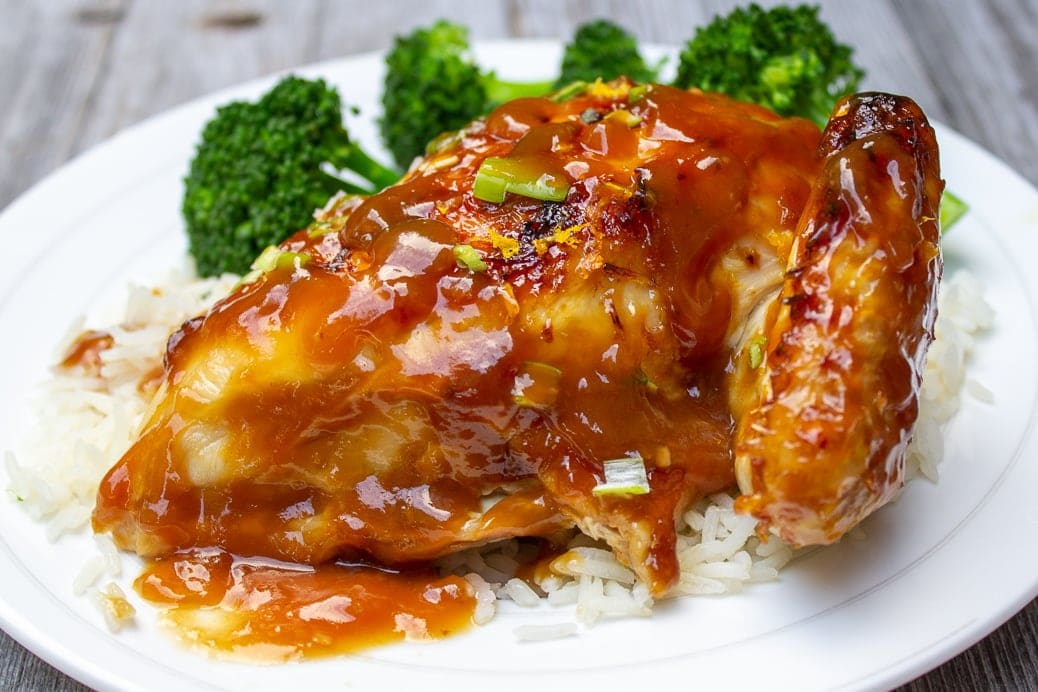 breast of Spatchcocked Roast Chicken with Teriyaki Glaze on plate with rice and broccoli