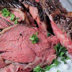 slices of medium rare prime rib on plate