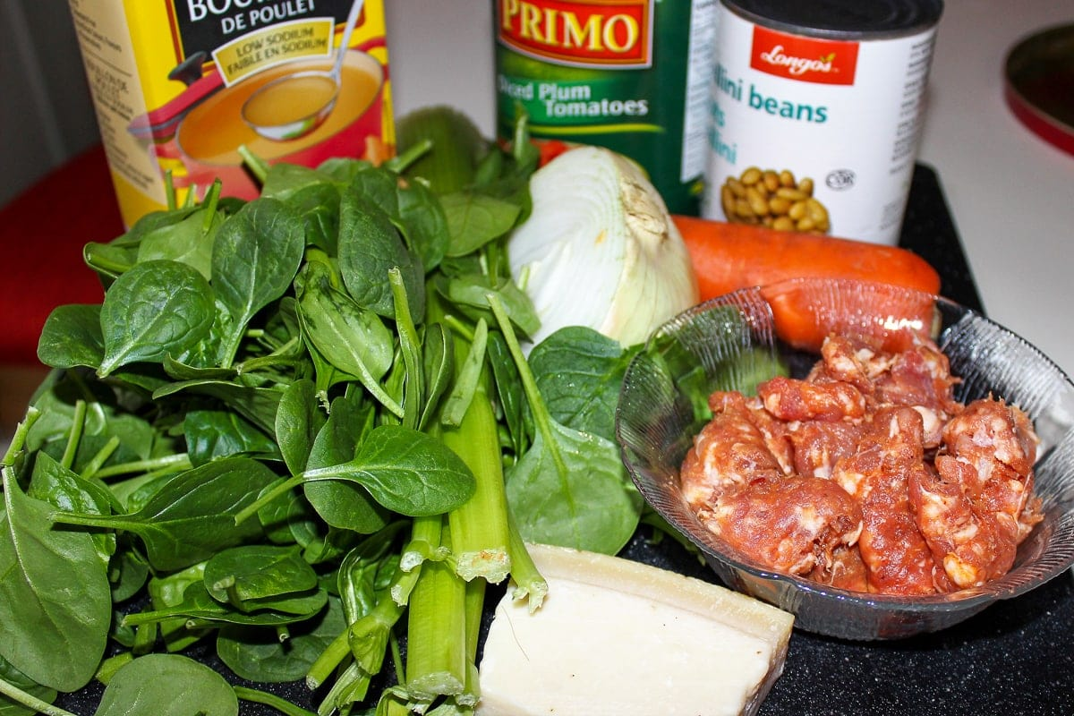 spinach, broth, can tomatoes, beans, onion, carrot, sausage, parmesan