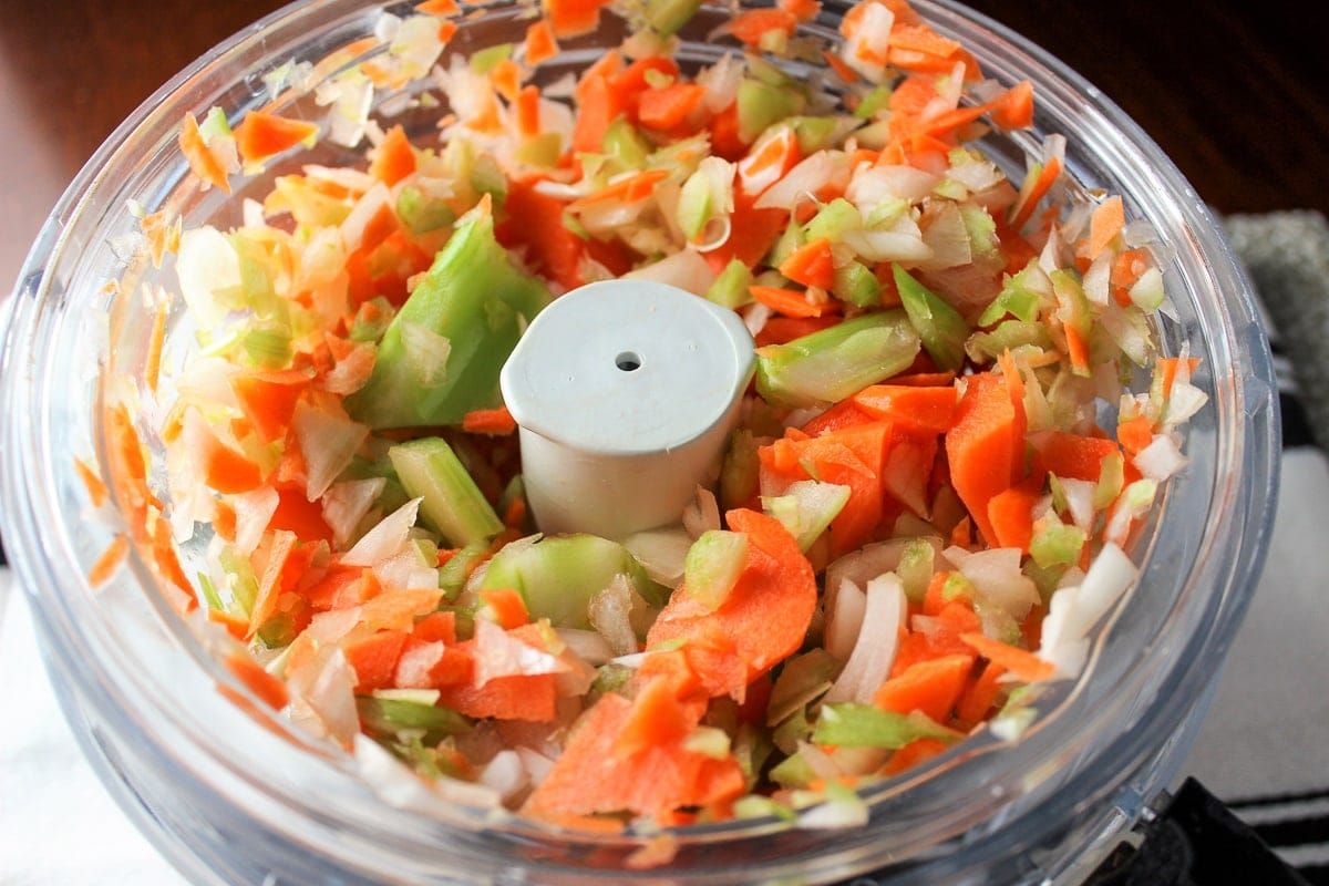 chopped vegetables in food processor bowl