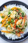 thai shrimp curry on rice on plate p