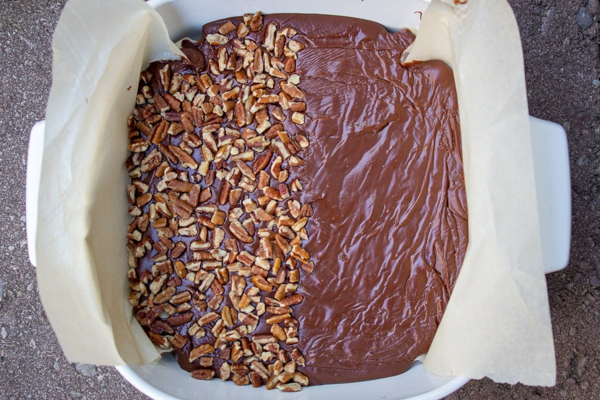 chocolate fudge mixture in parchment lined pan