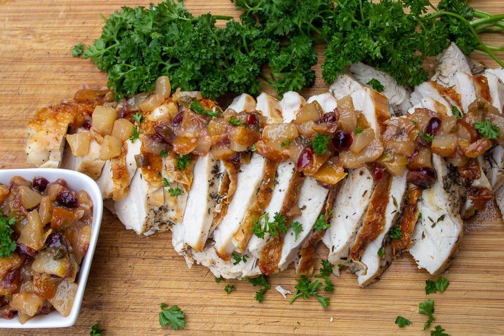 bone in turkey breast with pear chutney on cutting board 6