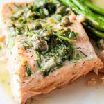 piece of sous vide salmon with lemon caper sauce and asparagus on plate p2