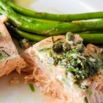 piece of sous vide salmon with lemon caper sauce and asparagus p1