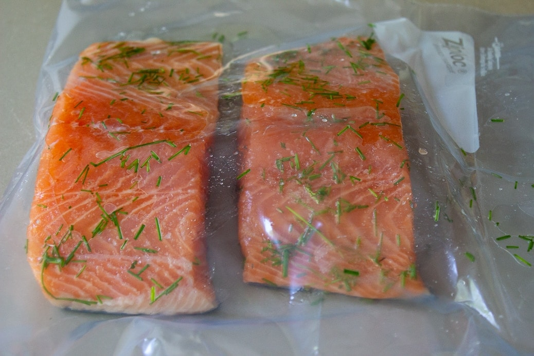 seasoned raw salmon fillets in zipper lock bag