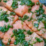 Sous vide salmon with caper sauce in pan