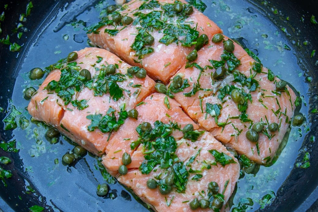 Sous vide salmon with caper sauce in pan 1