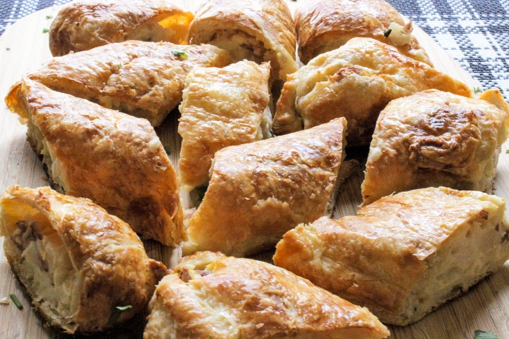 potato knishes on serving plate