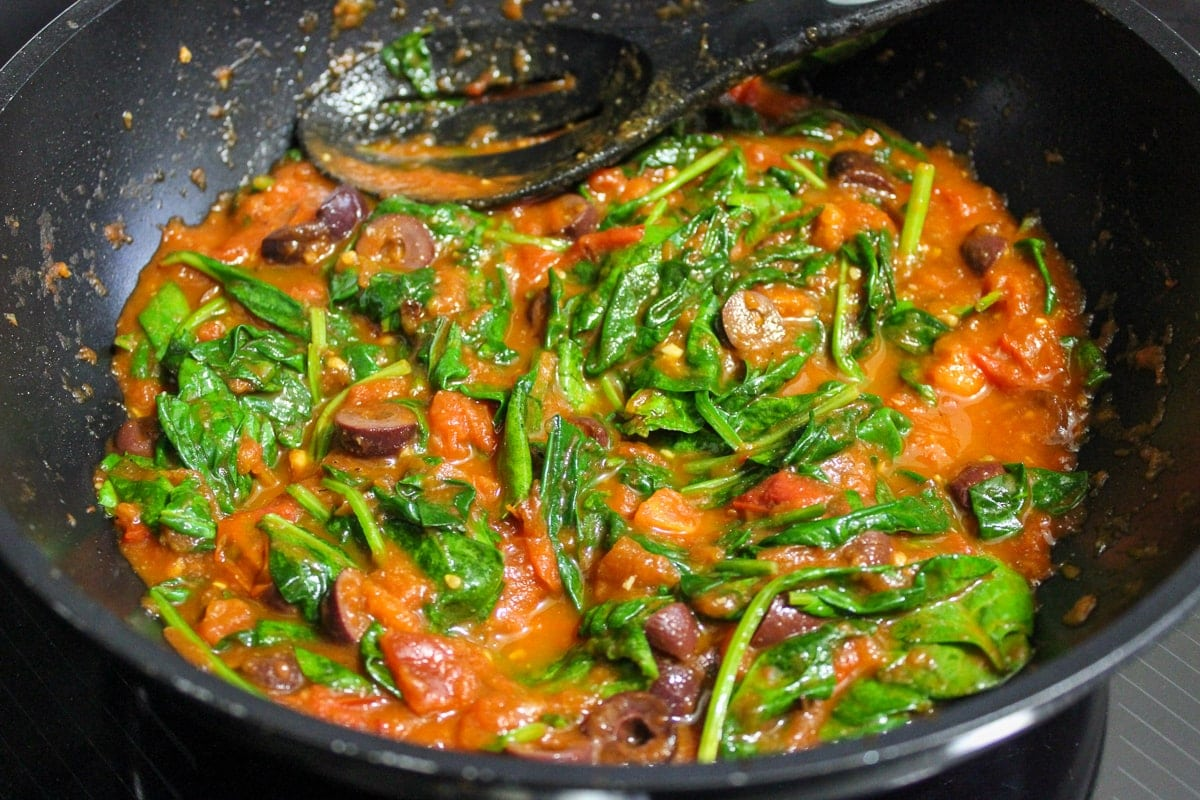 spinach added to sauce in pan