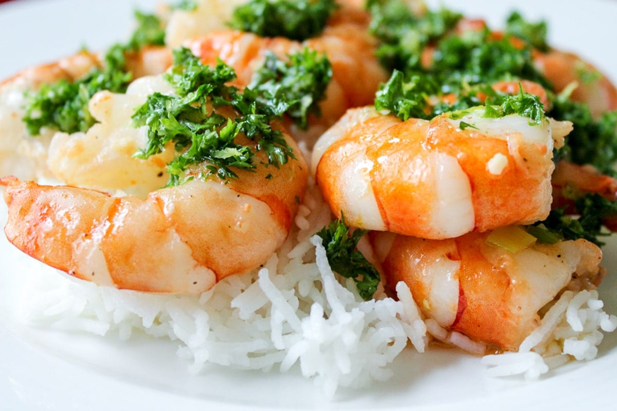 Shrimp with Gremolata Dressing over rice on plate