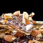 Matzo Caramel Almond Crunch pieces piled on a plate p1