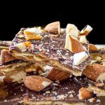 Matzo Caramel Almond Crunch pieces piled on a plate p