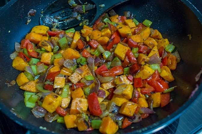 vegetables for quinoa stuffing in skillet