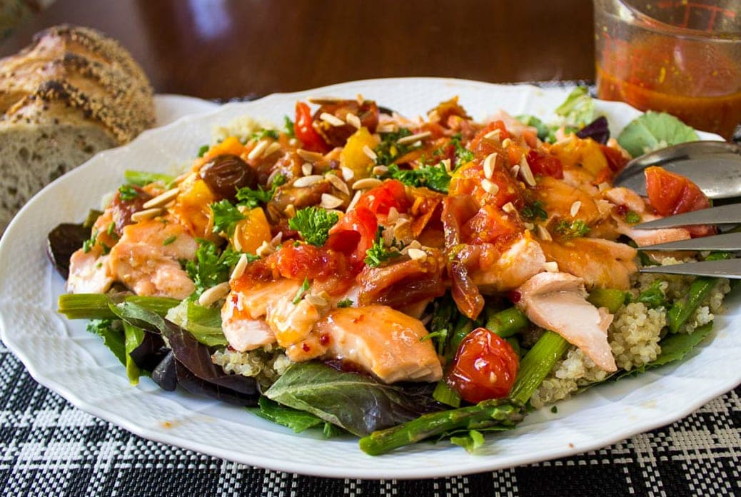 Warm Salmon Salad with Tomato Citrus Sauce served with crusty bread and extra sauce on side