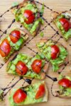 appetizers with avocado on crostini drizzled with balsamic reduction p