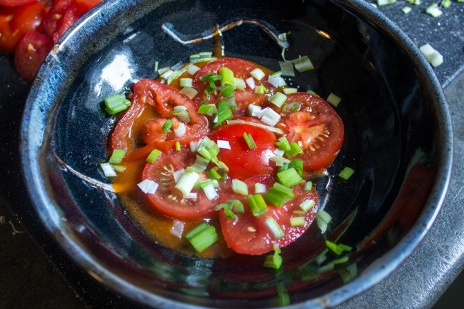 Tomatoes and green onions with Catalina Dressing partially completed
