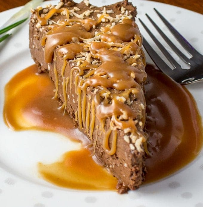 Chocolate Mousse with Warm Caramel Sauce on plate with flower beside it