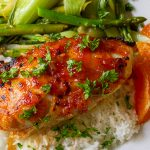 apricot chicken breast on plate with rice and bok choy p