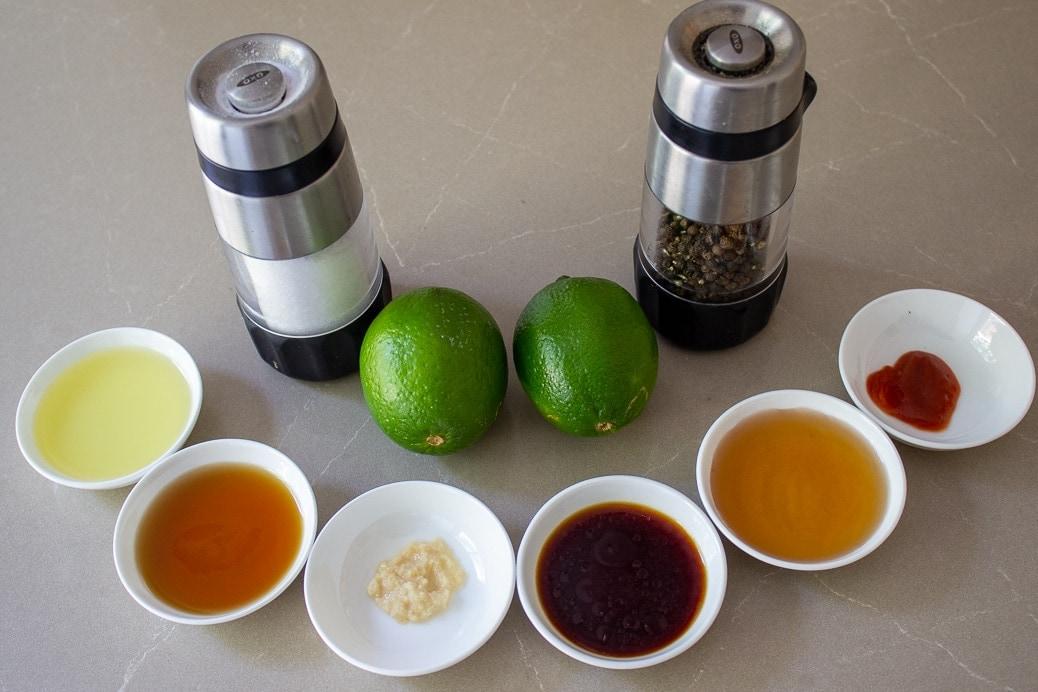 oil, sesame oil, garlic, soy, maple syrup, sriracha, limes, salt, pepper