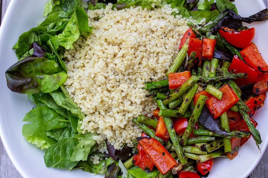 greens, grilled veggies and quinoa in a bowl