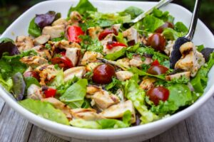 Grilled sesame-lime chicken quinoa salad in a bowl f