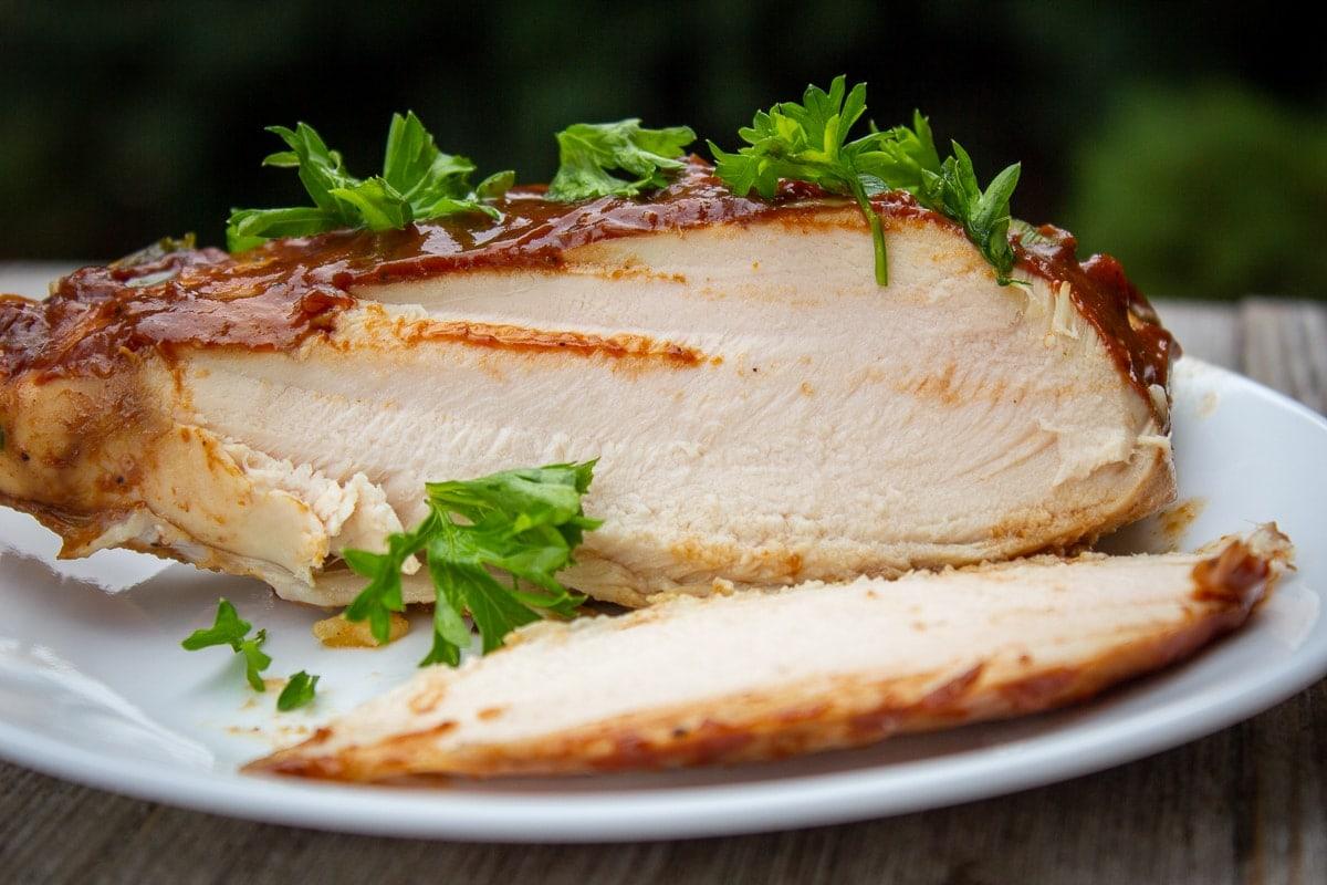 bone in balsmic glazed chicken breast cut open on plate