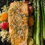 Maple Lime Salmon on black late with cherry tomatoes, quinoa and asparagus