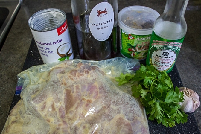 chicken with thai marinade in ziploc bag and thai sauce ingredients