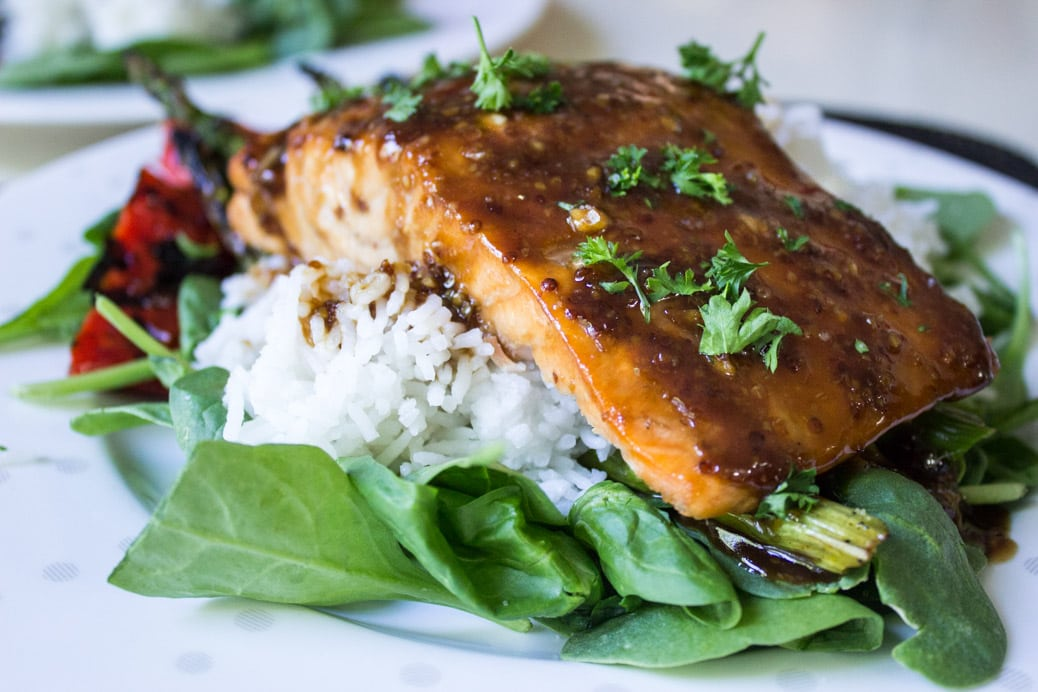 Canadian Maple Planked Salmon. Pure maple syrup, grainy mustard, balsamic vinegar, butter and garlic make a luscious glaze for this smoky moist salmon.