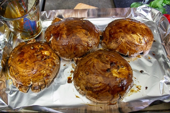 Portobello Mushrooms marinating on pan