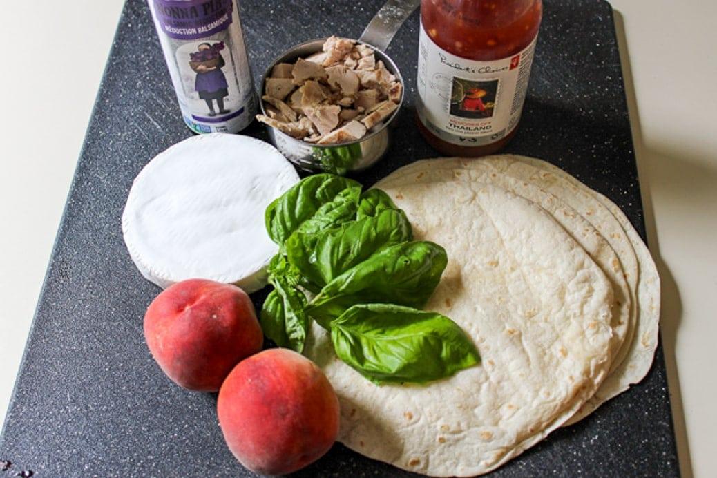 Ingredients: peaches, brie, chicken, balsamic glaze, sweet chili sauce, tortillas, fresh basil.
